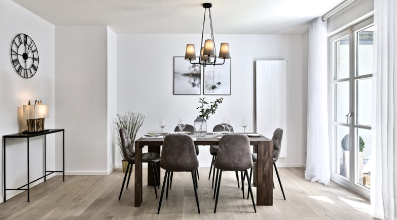 Re-vamp upholstery living. Dinning room, with brown velveted chairs around a square table, a chandelier on top and some plants around the room